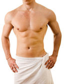 Wet muscular sexy man wrapped in the towel, isolated on white — Stock Photo