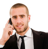 Close-up of young business man talking on the mobile phone, over — Photo