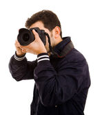 Young male photographer with camera, isolated on white — Stock Photo
