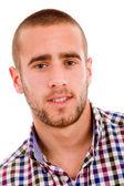 Yakın çekim üzerinde beyaz backgr izole mutlu genç bir adam portresi — Stok fotoğraf