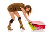 Belle femme élégante, tirant sur les sacs à provisions — Photo