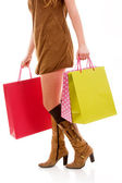 Elegancki młoda kobieta z torby na zakupy na białym tle — Zdjęcie stockowe