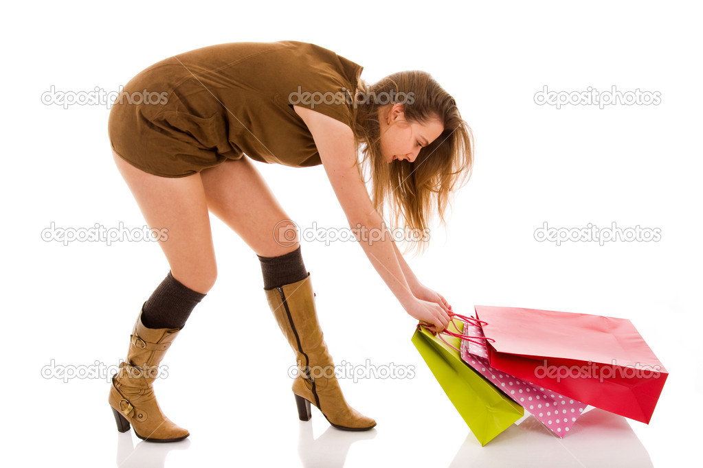 Beautiful stylish woman pulling shopping bags — Stock Photo #9361676