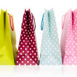 assorted colored shopping bags on white background — Stock Photo