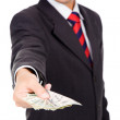 Image of a business man holding,offering money, isolated on whit — Stock Photo