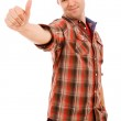 Happy young man showing thumb up and smiling. Isolated on white — Stock Photo #9377906