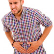 Stock Photo: Young mwith strong stomach pain isolated on white background