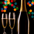 Champagne glasses and bottle — Stock Photo #9378578