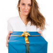 Girl smiles and giving a gift — Stock Photo #9378624