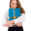 Girl smiles and holding a gift — Stock Photo #9378628