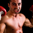 Young Boxer fighter over black background — Stock Photo