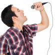 Handsome young man singing — Stock Photo #9379210