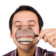 Funny man with magnifying glass — Stock Photo #9379215