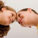 Below view of happy children smiling — Stock Photo