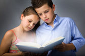 Image of smart children reading interesting book — Stock Photo