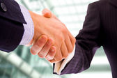 Business men hand shake at the office — Stock Photo