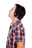 Profile view of a happy young man listening music. Isolated on w — Foto de Stock
