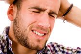 Young man in agony with an intense headache — Stock Photo