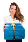 Girl smiles and giving a gift — Stock Photo