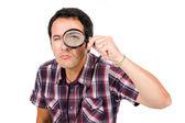 člověk při pohledu přes zvětšovací sklo — Stock fotografie
