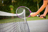 Woman holding tennis racket and ball — Stock Photo