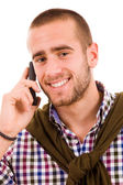Happy young man using mobile phone — Stock Photo