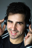 Handsome young man listening the music — Stock Photo