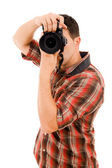 Young photographer with camera — Stock Photo