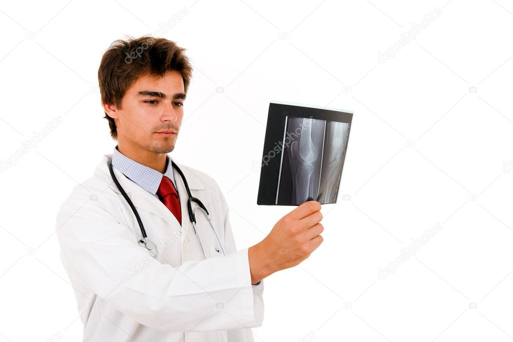 Young doctor checking xray results on white background — Stock Photo #9378976