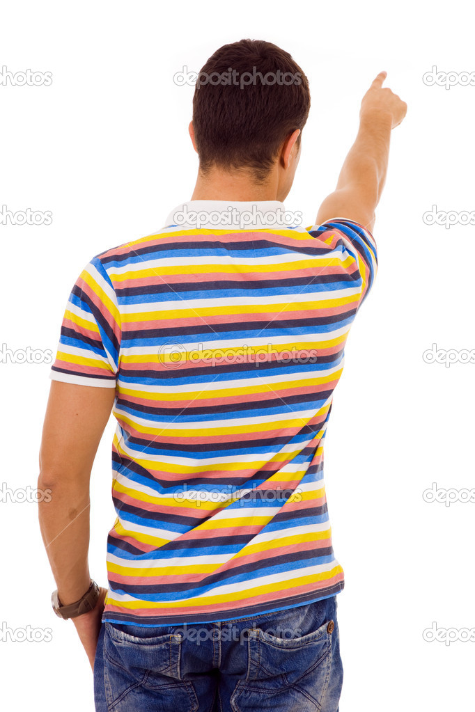 Young casual man pointing against white background — Stock Photo #9379157