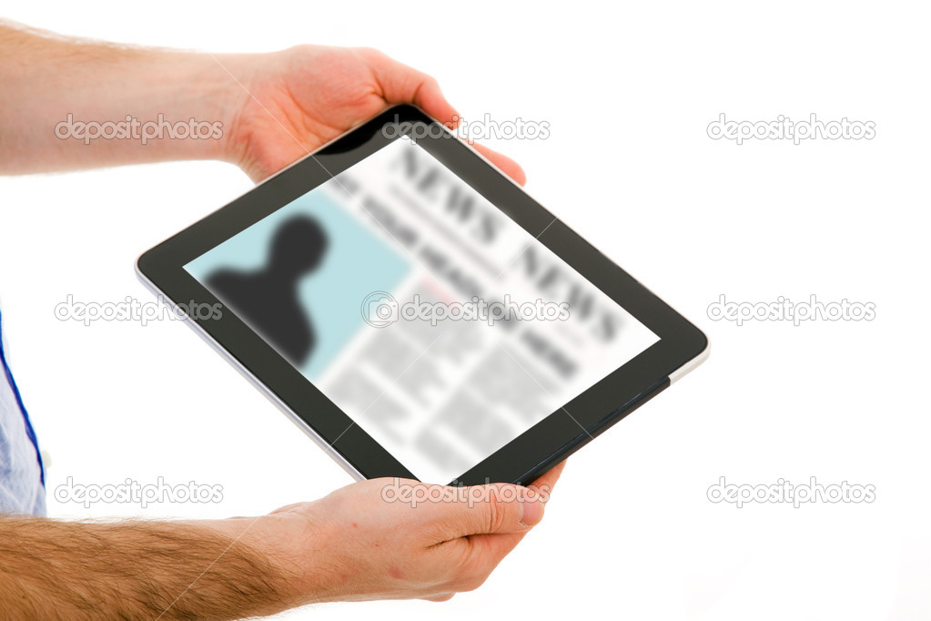 Image of man hands holding a touchpad computer and reading the news. Isolated on white. — Stock Photo #9379185