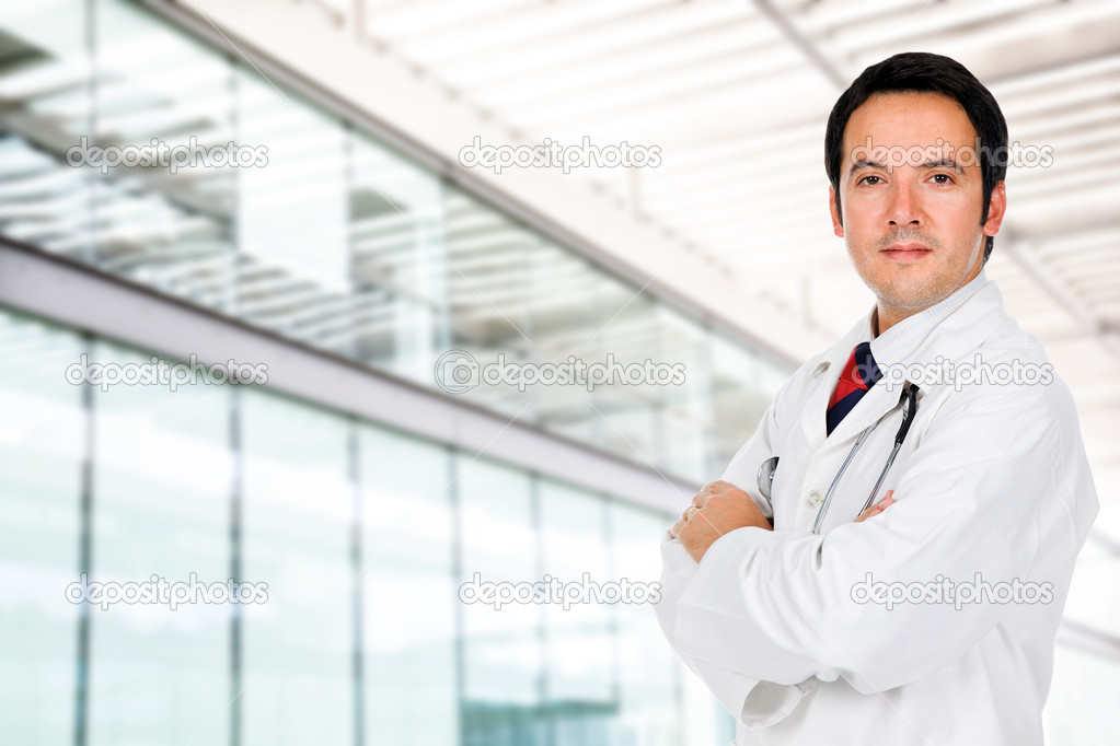 Portrait of a male doctor at a modern hospital — Stock Photo #9379248