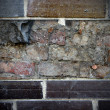Brick wall and the old wall — Stock Photo