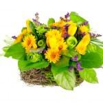 Basket of roses, tulips and limonium — Stock Photo