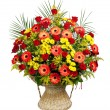 Stock Photo: Basket of roses, gerberas and palm leaves