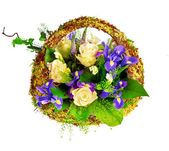 Basket of roses, iris dutch xiphium, and veronica — Stock Photo