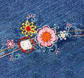 Embroidery on denim — Stock Photo