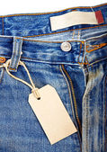 Unbuttoned blue jeans with paper label — Stock Photo