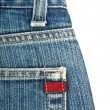 Blue denim jeans with red label — Stock Photo #9589080