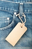 Blue denim jeans with paper label — Stock Photo