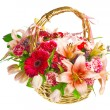 Stock Photo: Gift basket of lilias, roses and gerberas