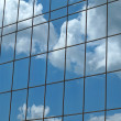 Stock Photo: Clouds Reflection in Modern Office Block Windows