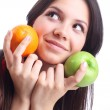 Young woman hold fruit - apple and orange. Isolated — Stock Photo