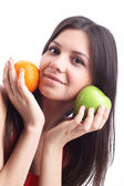 Young woman with fruit - apple and orange. Isolated — Stock Photo