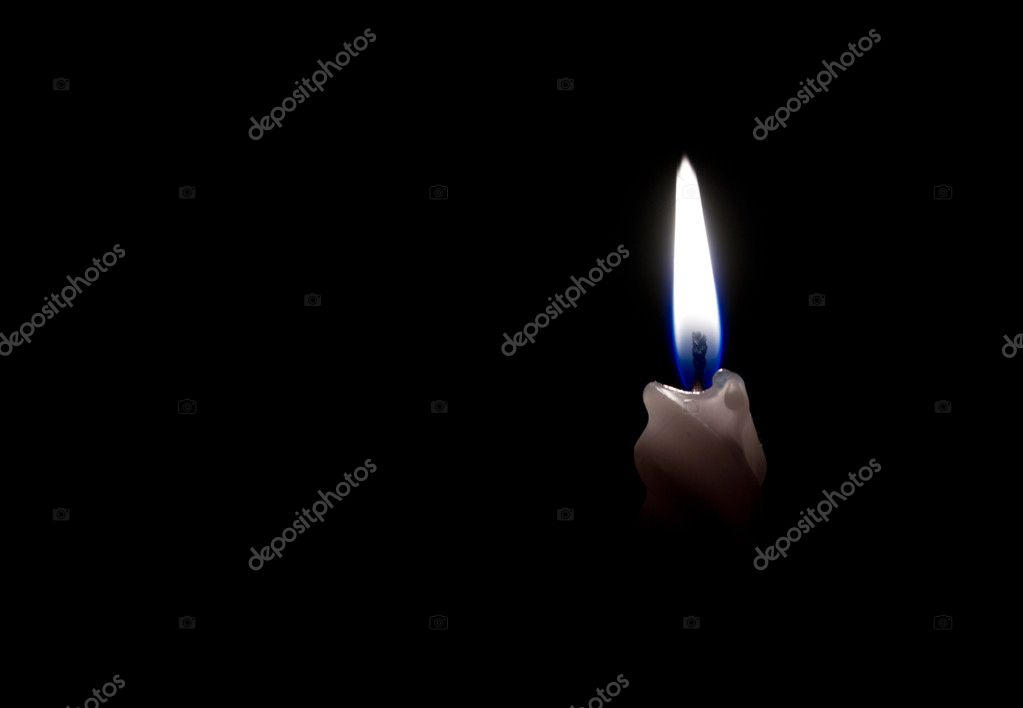 A burning candle in the dark on a black background — Stock Photo #8505279
