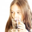 Girl holding a glass of water — Stock Photo