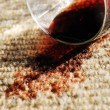 Red Wine Spill on a Pure Wool Carpet - Stock Photo