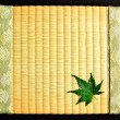Japanese green maple leaf on tatami mat — Stock Photo #10067753