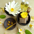 White water lily and Asian spa supplies - Stock Photo