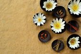 White water lily and incense on craft paper — Stock Photo